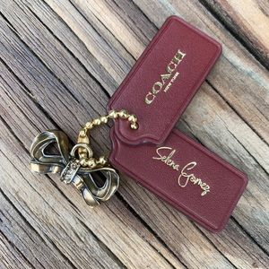 Coach Bow charm and 2 leather hang tags